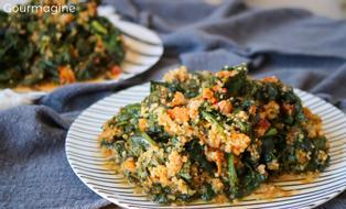 A plate filled with spinach, quinoa and carrots