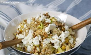 A bowl filled with quinoa, peppers and feta cheese
